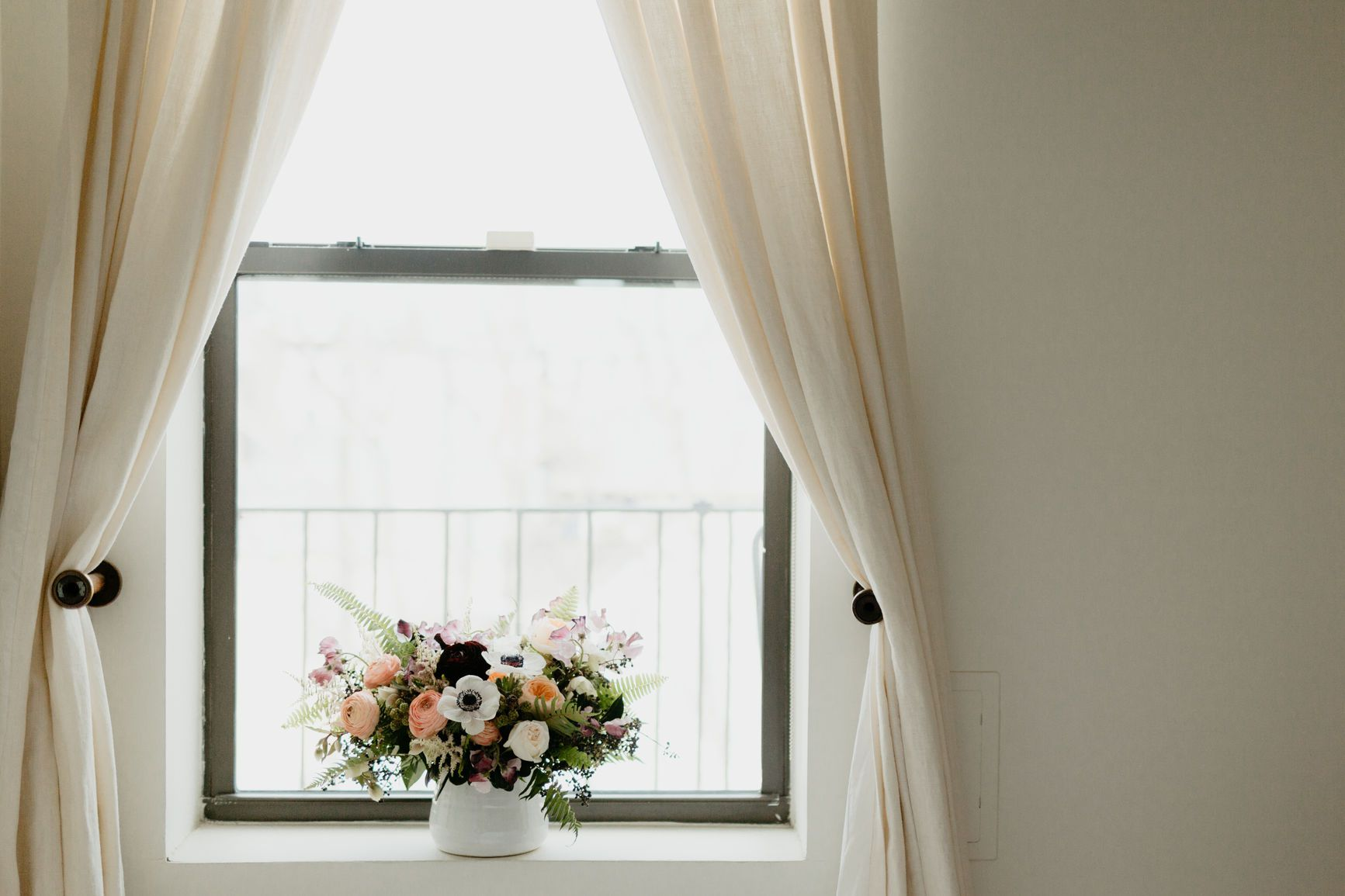 window treatment with curtains and flowers