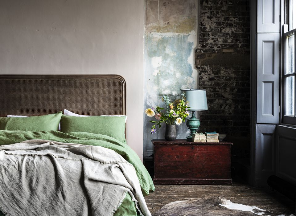 Bedroom featuring Piglet green linen sheets
