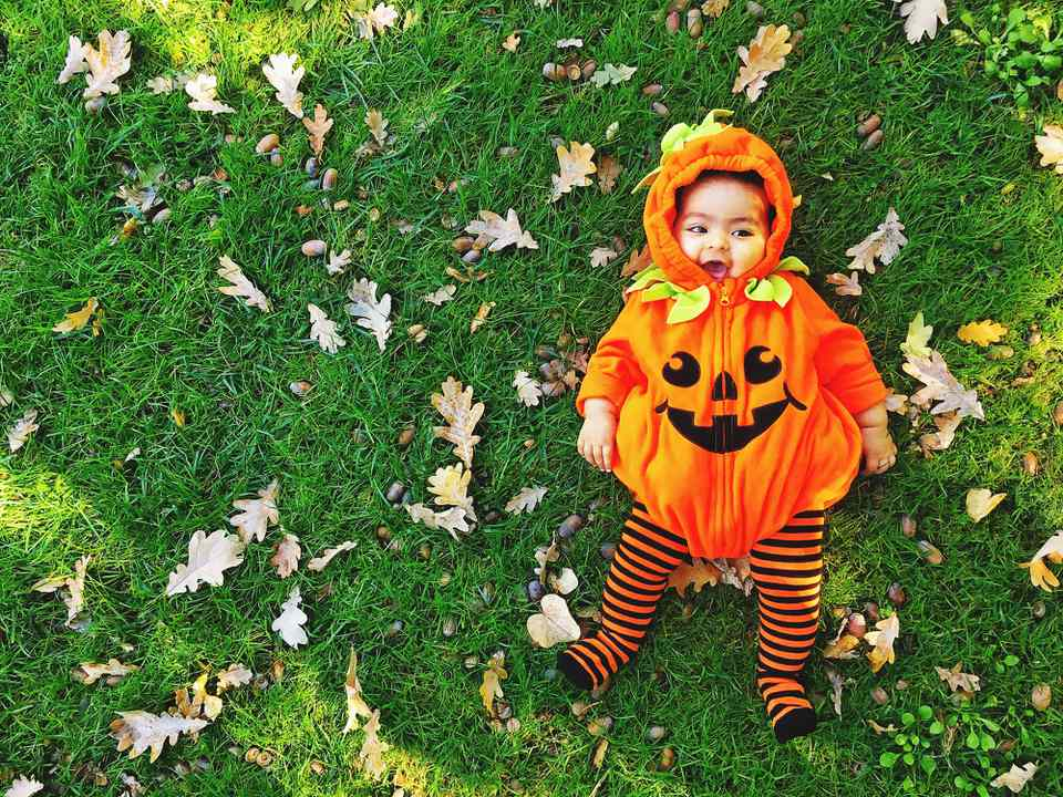 baby dressed as a pumpkin