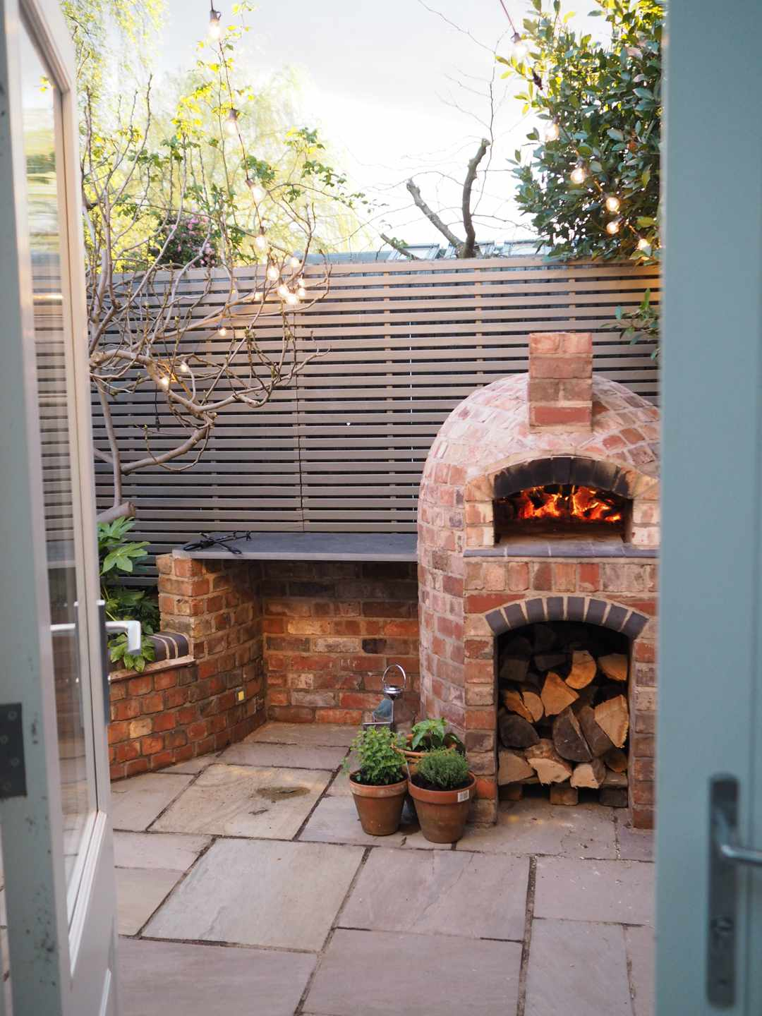 Small outdoor kitchen with wood pizza oven