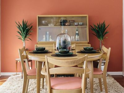 Dining room with coral paint