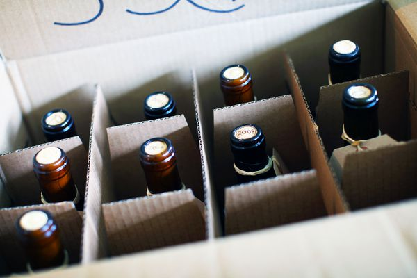 Wine bottles in a moving box ready to ship