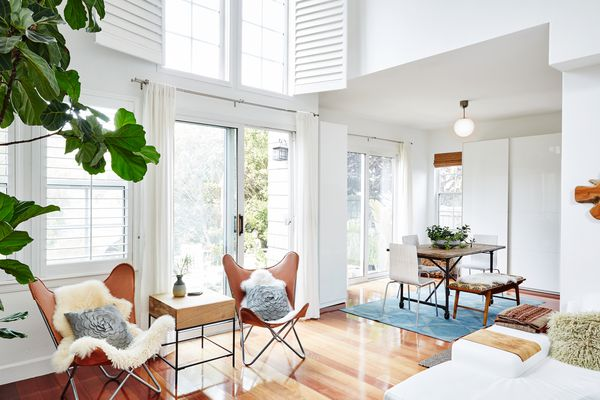 Clean house with two chairs and a dining set