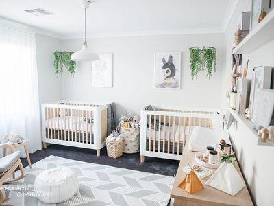 Boho chic twin nursery with nature theme