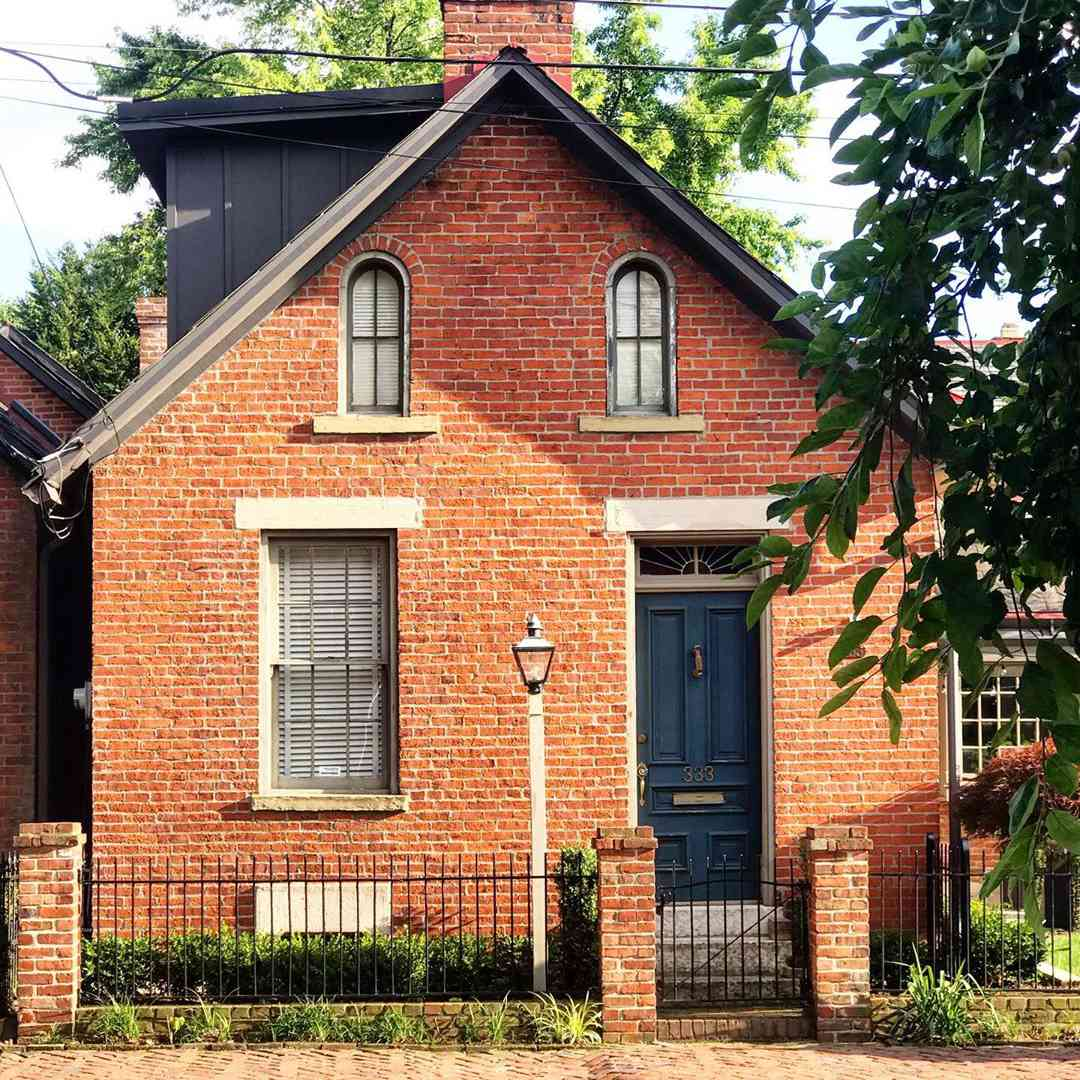 Brick house with a black front door