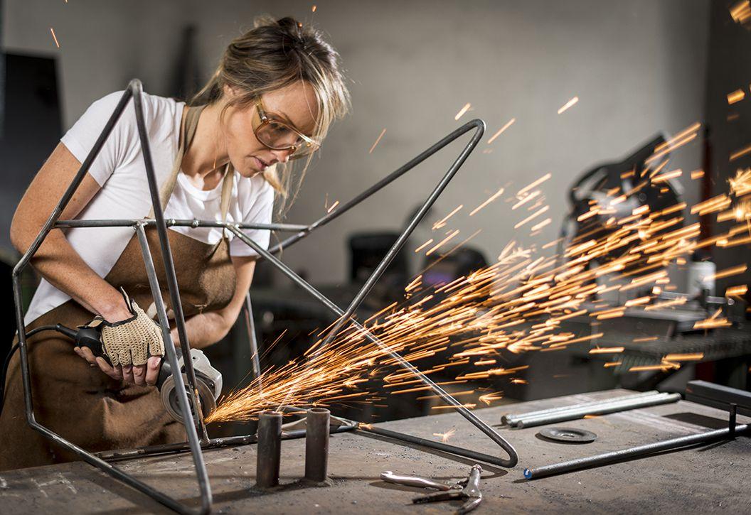 Greta de Parry solders a metal base for Girls Who Build
