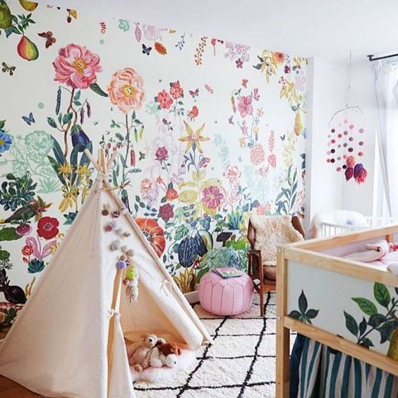 Modern Boho nursery with gorgeous floral accent wall