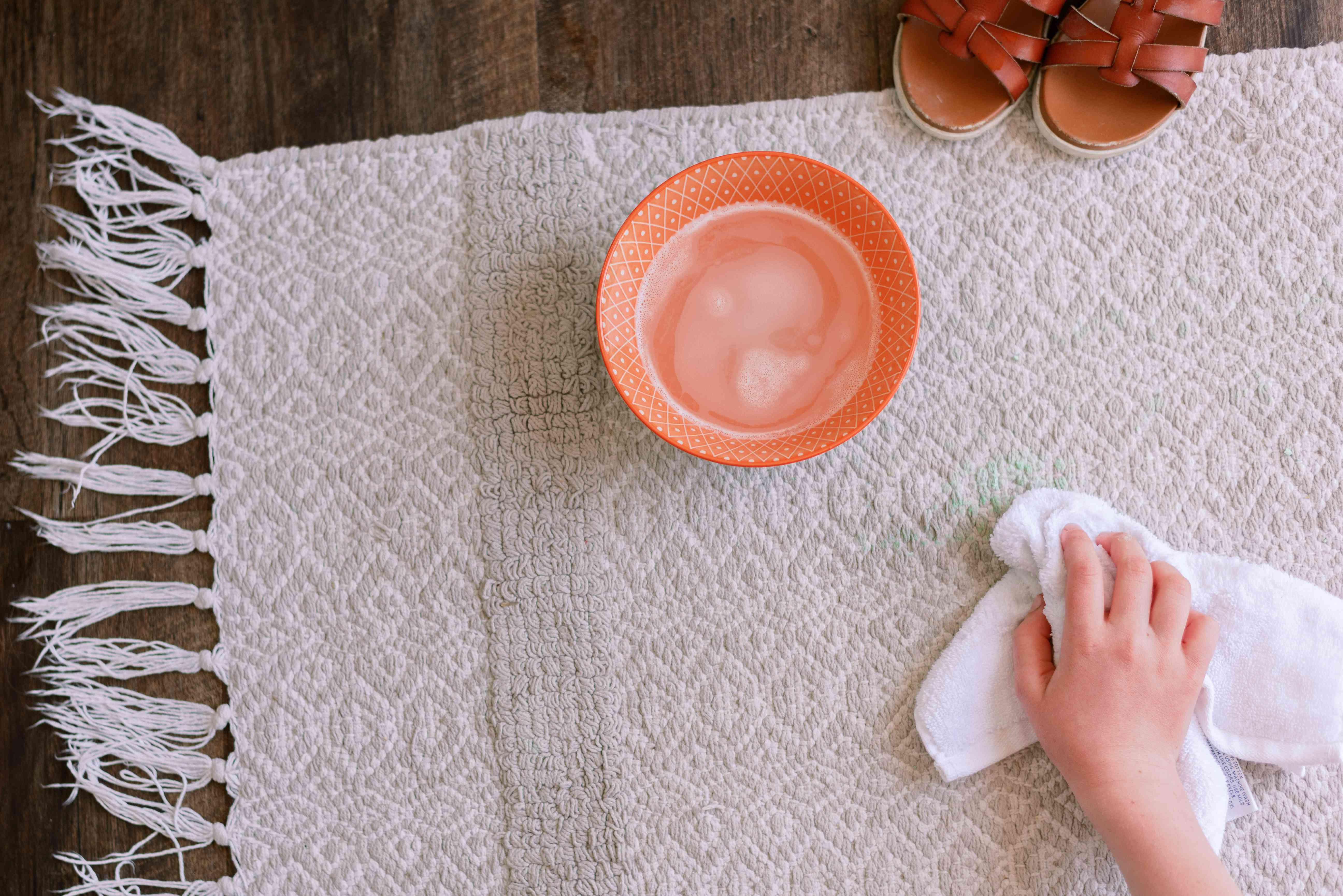 blotting the chalk stain with dishwashing liquid