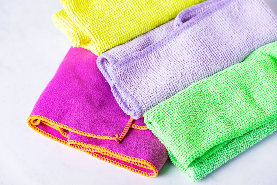 Brightly-colored microfiber towels folded closeup