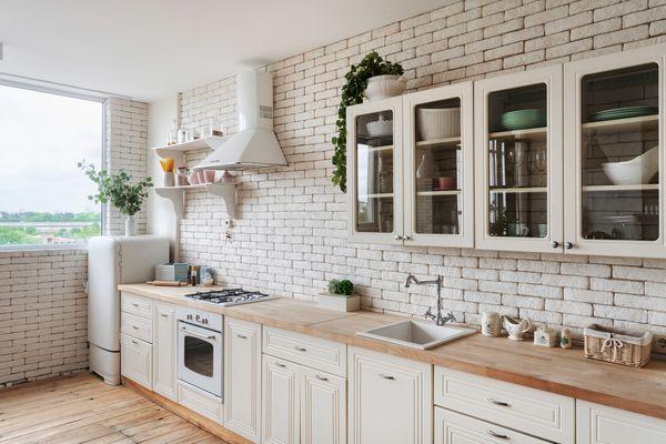 White kitchen in apartment with modern interior