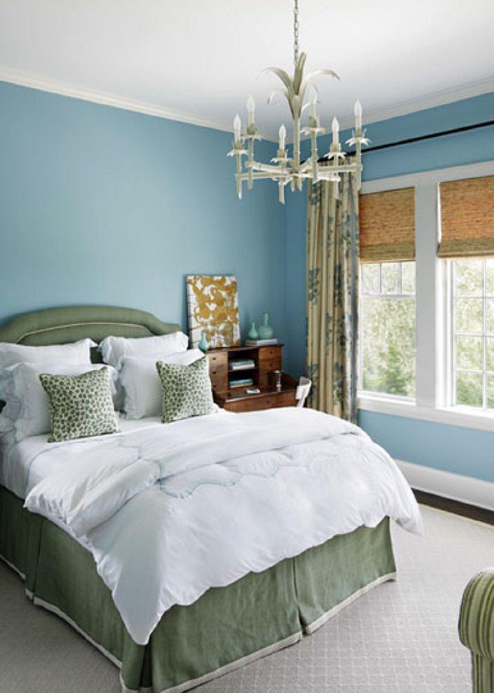 Blue walls in pretty bedroom.