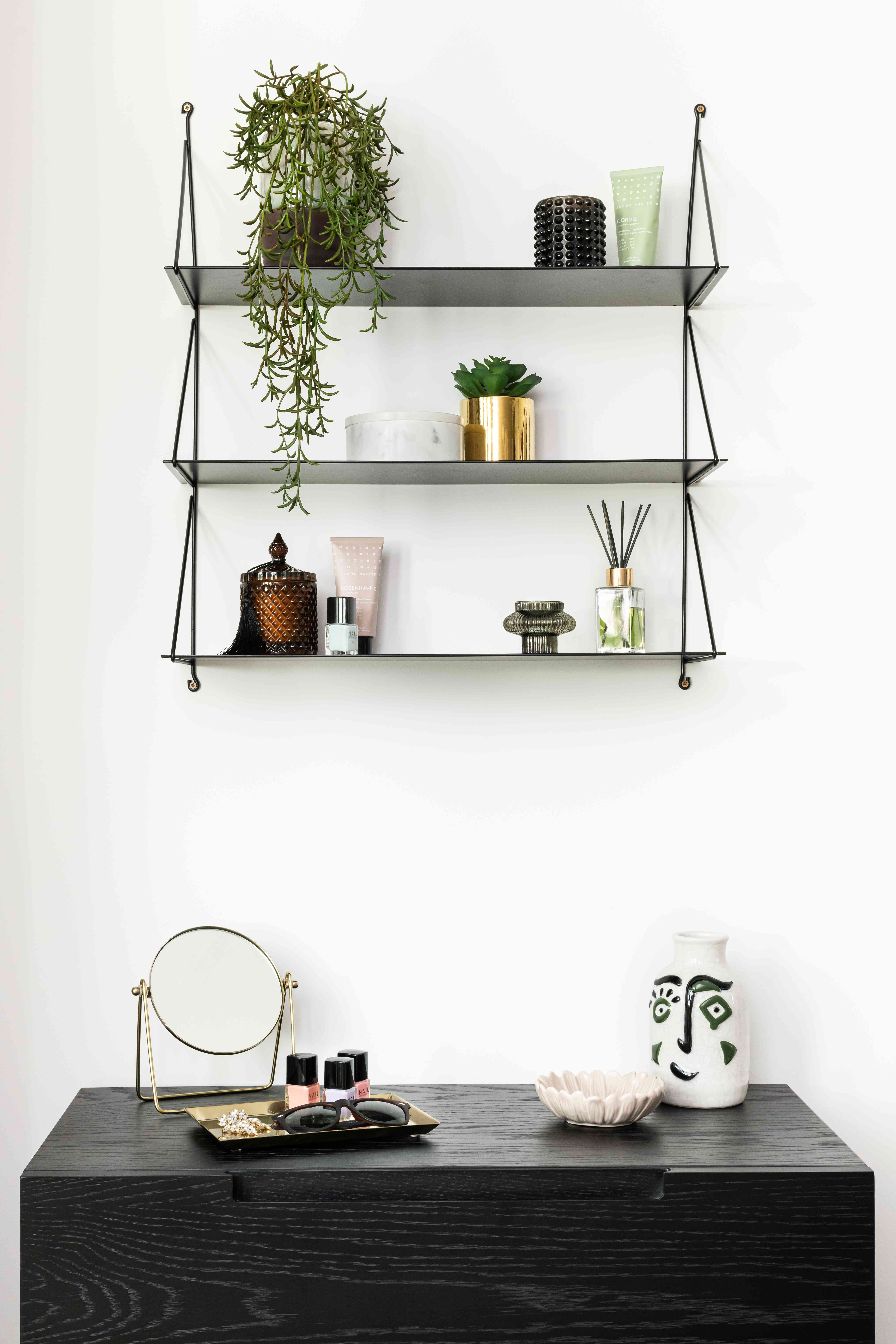 styled wall shelves feature plants and follow the triangle rule