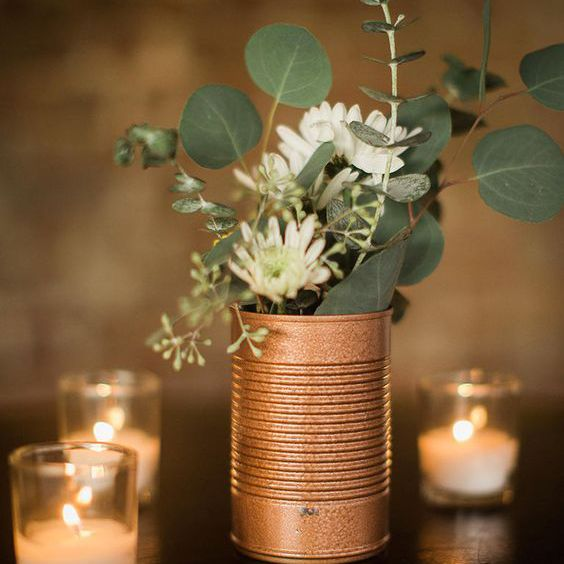 can centerpiece with flowers