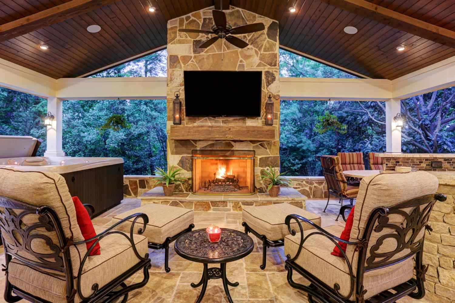 covered patio outdoor living room and fireplace