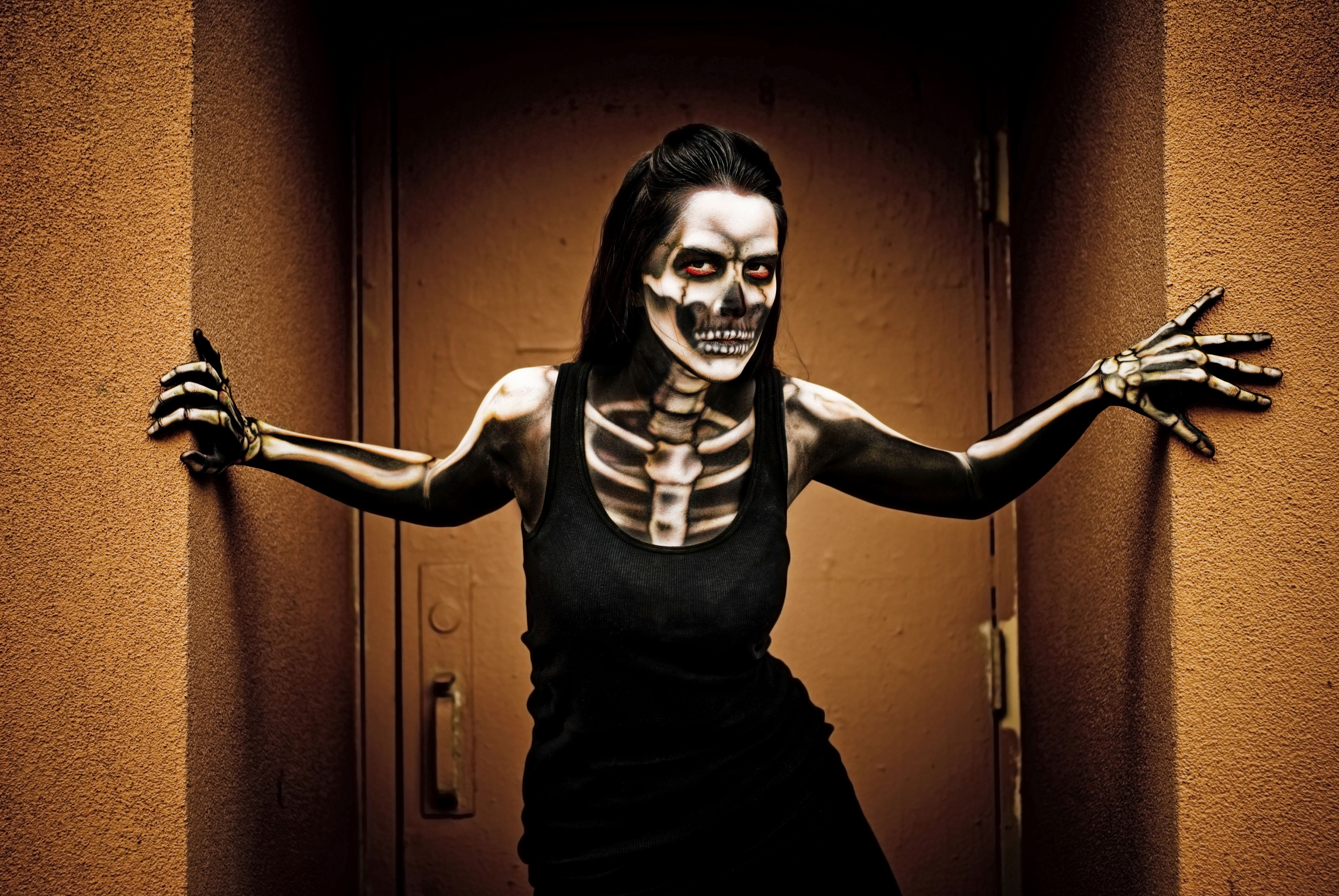 Woman airbrushed as a skeleton