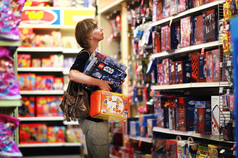 Woman shopping for toys in a store.