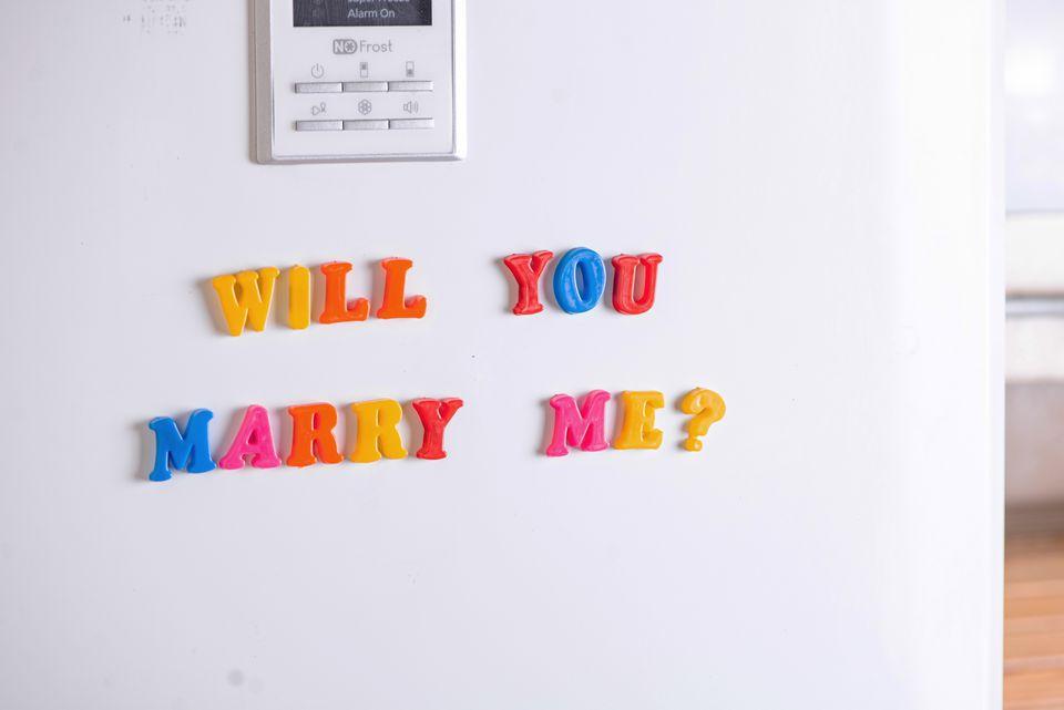 marriage proposal on a refrigerator door
