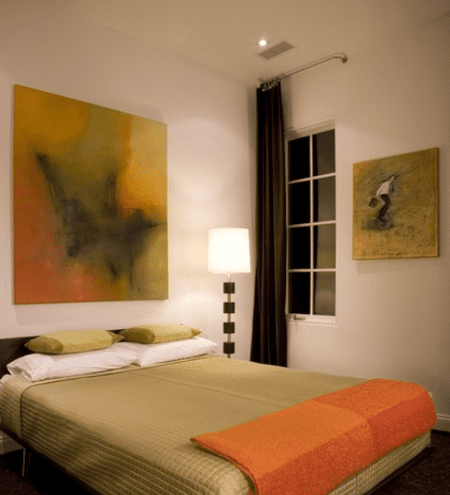 Brown Green And Orange Bedroom With Artwork On The Wall