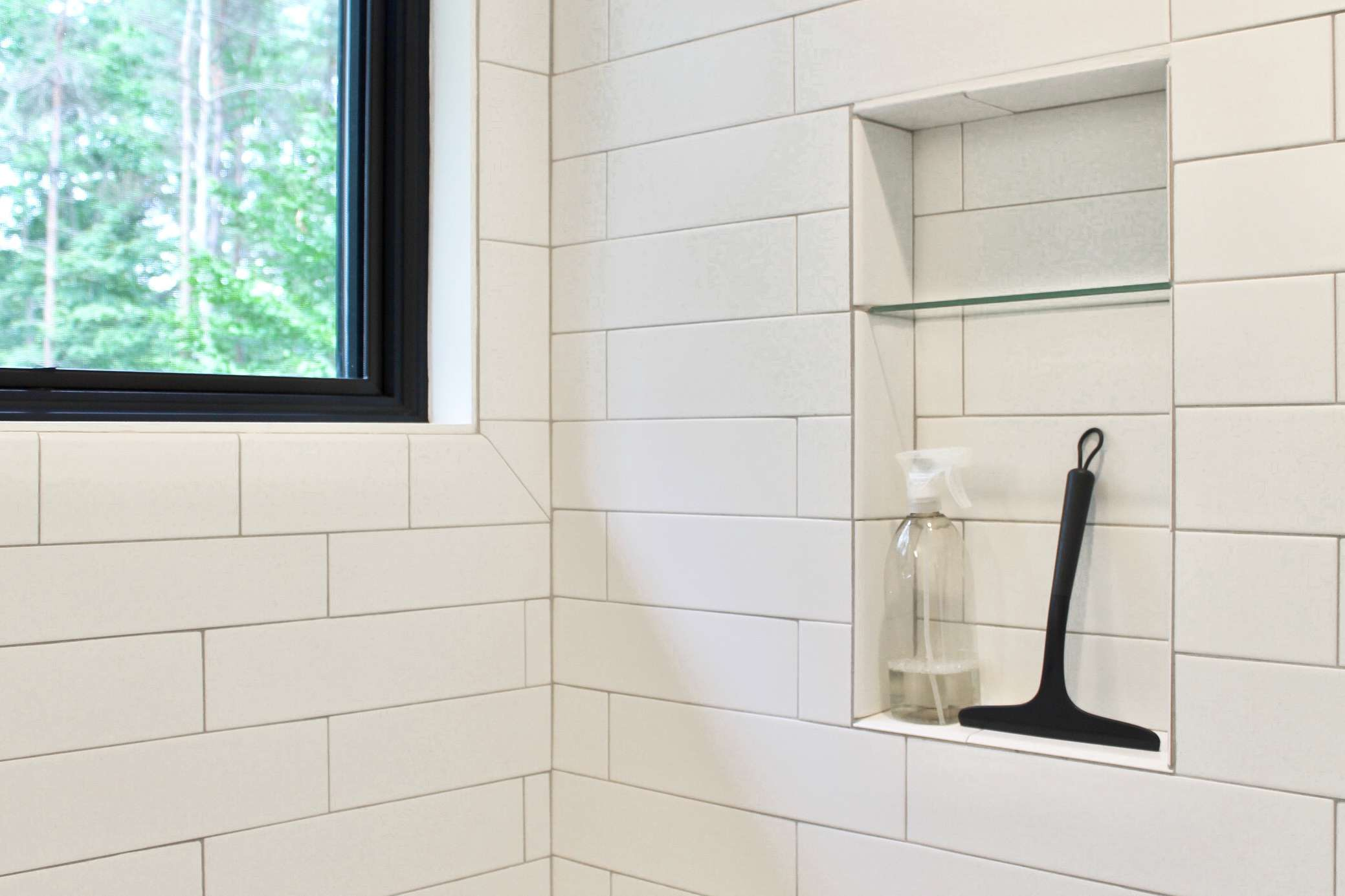 squeegee and spray for post-shower mineral deposit prevention