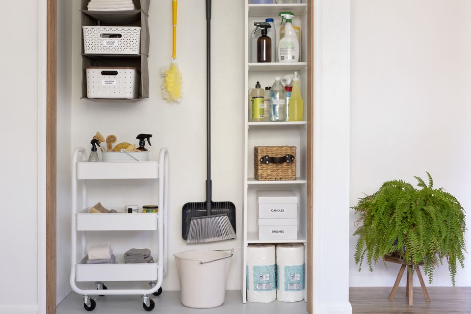 Cleaning supplies stored and organized along wall and with shelving