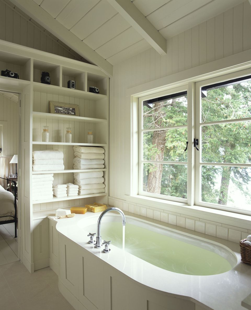 Bathtub in white wooden bathroom