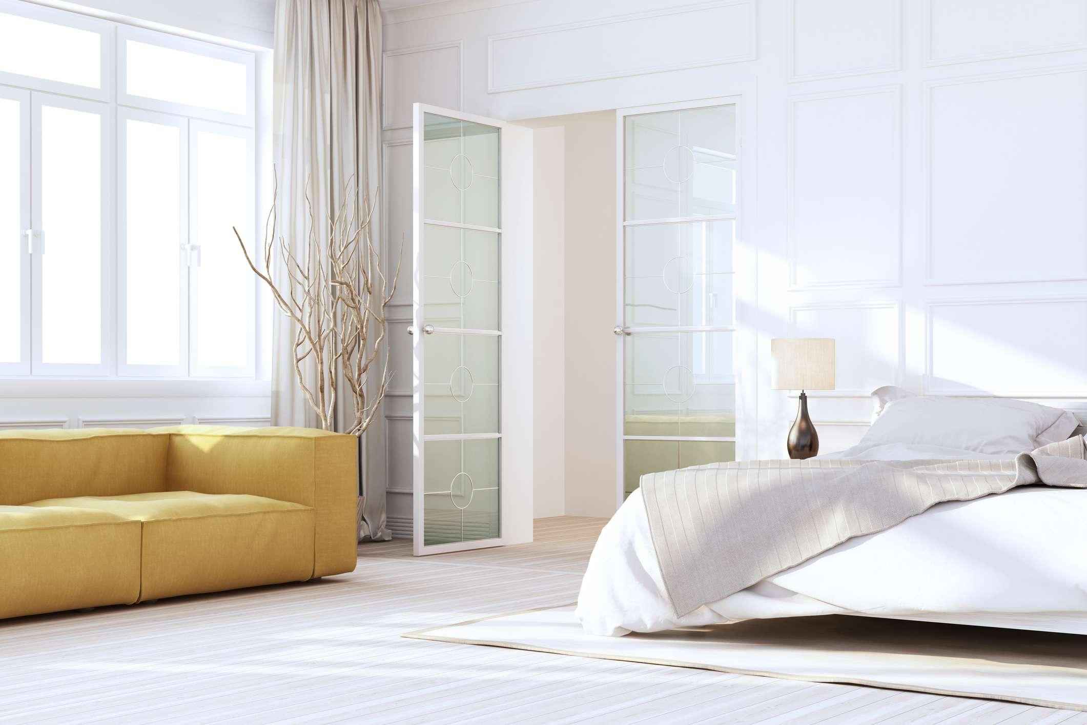 White Luxury Bedroom Interior with yellow sofa and glass doors