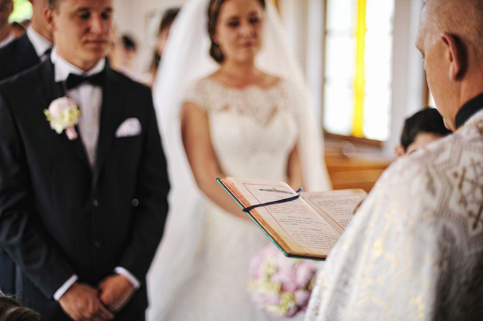 Priest reading during Catholic wedding