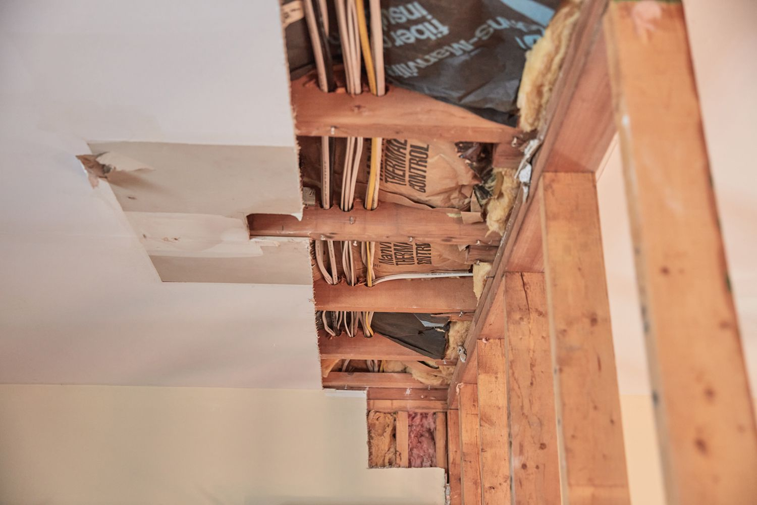 Wooden joints exposed in ceiling of load bearing wall