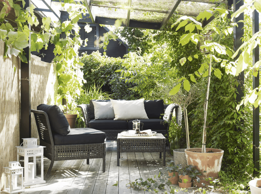Outdoor furniture with luxe greenery