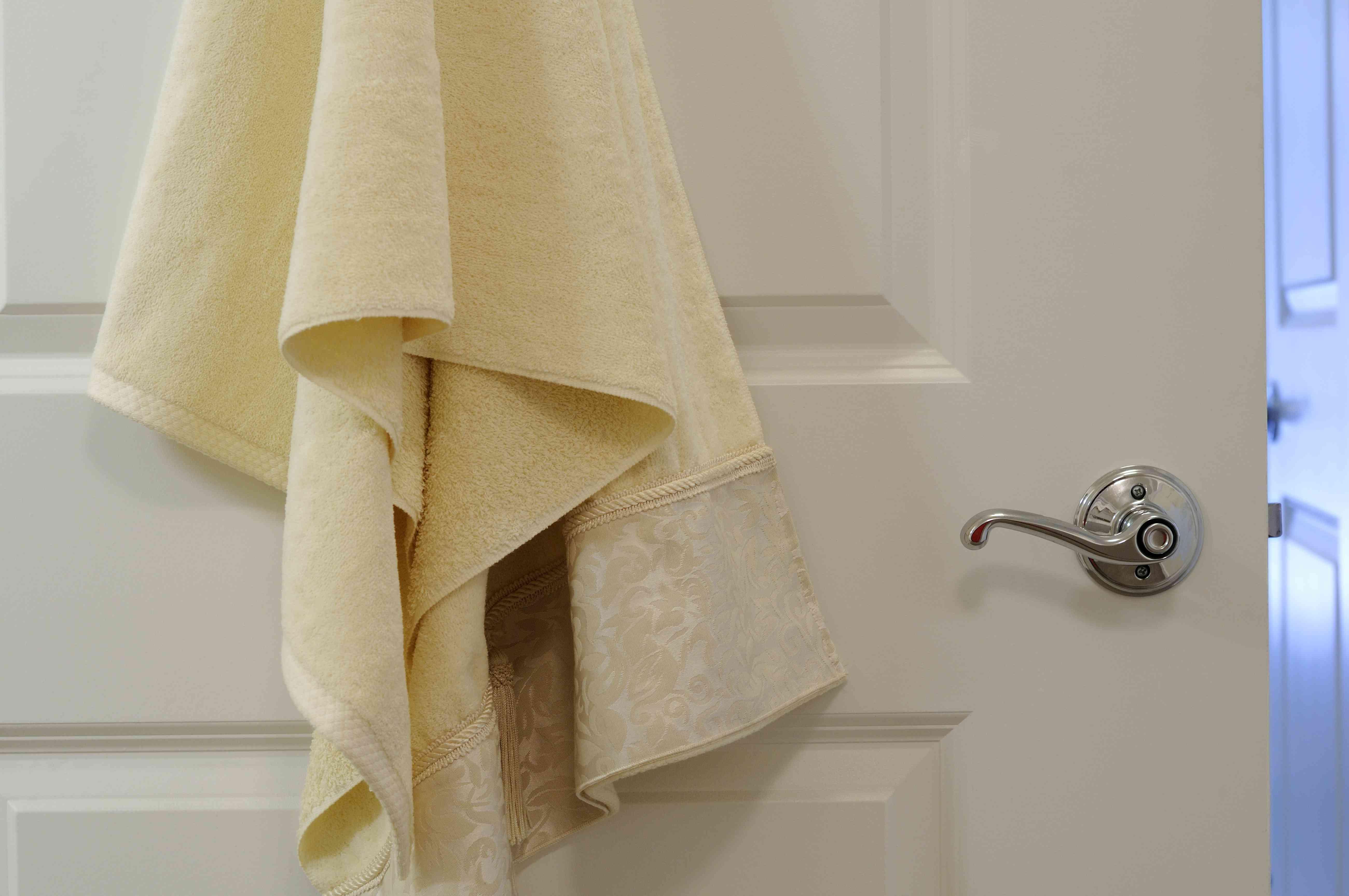 Towel hanging on door