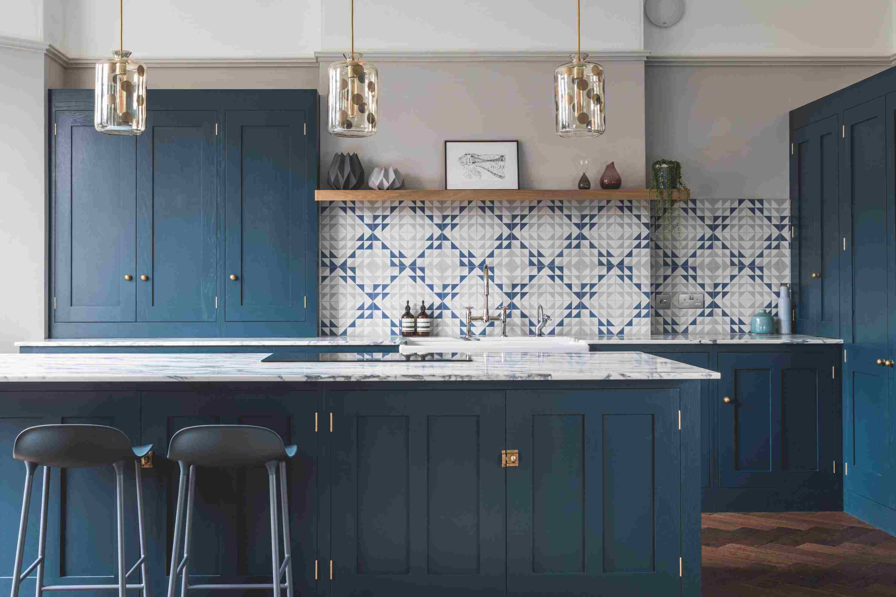 blue kitchen that shows of wood grain