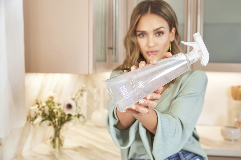 Jessica Alba holding a bottle of Honest Multi-Purpose Cleaner