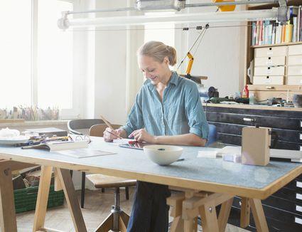 Woman architect at workbench
