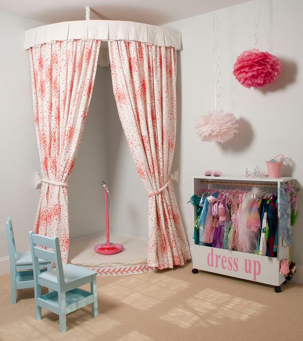 Girl's room with curtained costume corner and stage