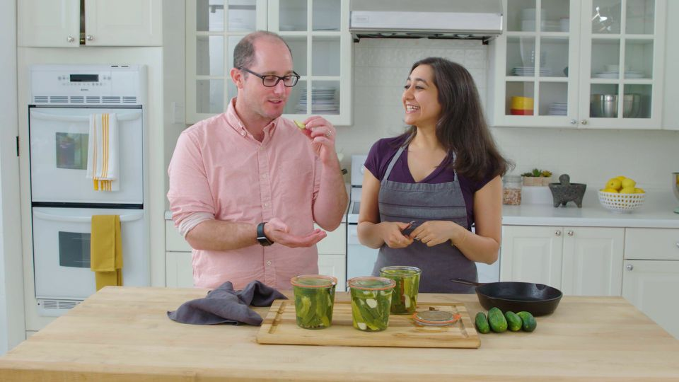 Eric Handelsman and Jess Kapadia eating pickles
