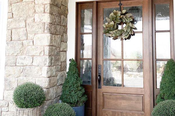 Brown front door with side glass