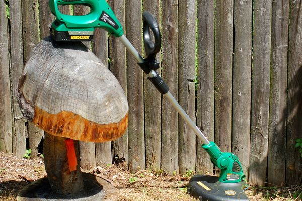 Many who want a manicured look in a yard wouldn't know what to do without string trimmers (image).