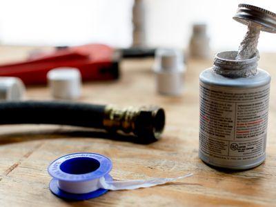 teflon tape and plumber's tools