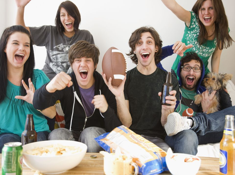 Picture of several people celebrating during the Super Bowl