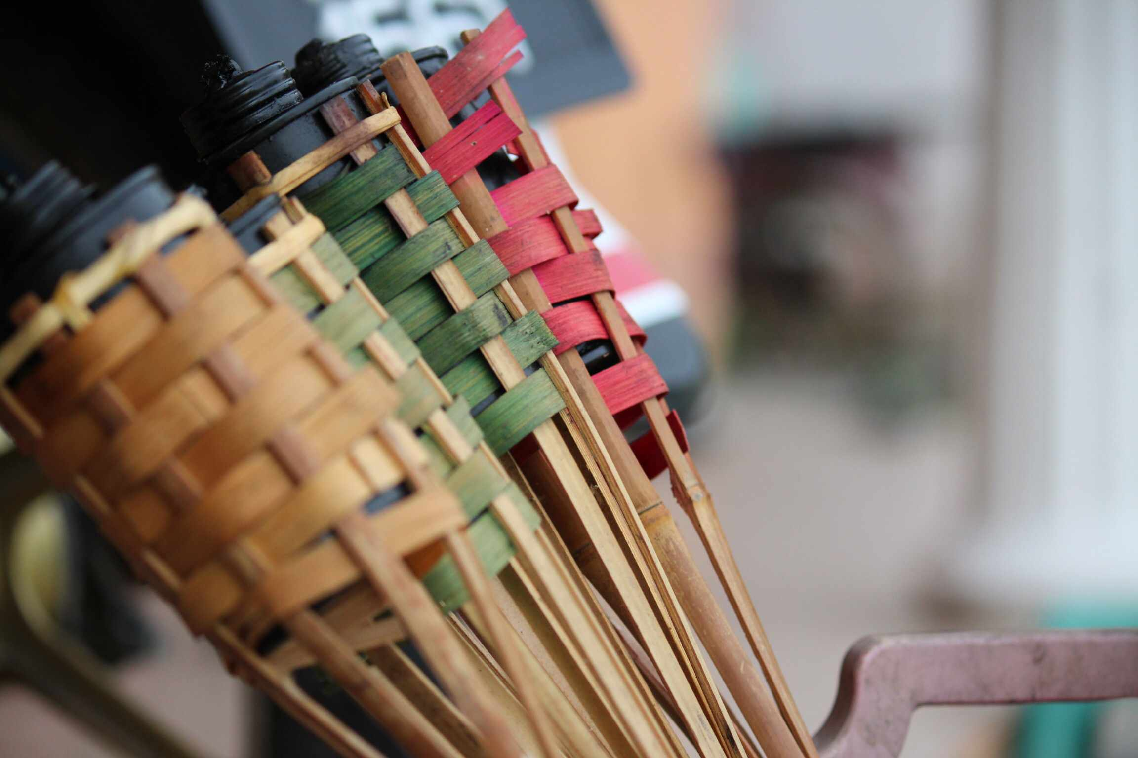 Close-Up Of Tiki Torches Outdoors