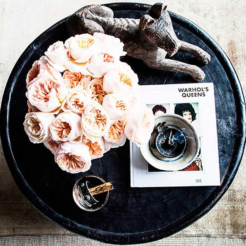 Stylish table vignette built around fresh pink roses