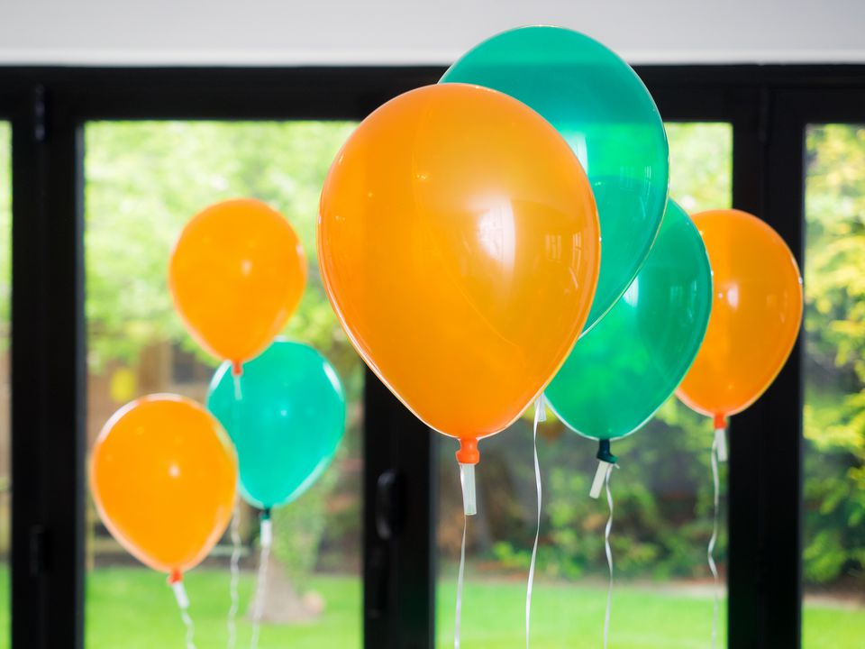 A set of orange and green balloons