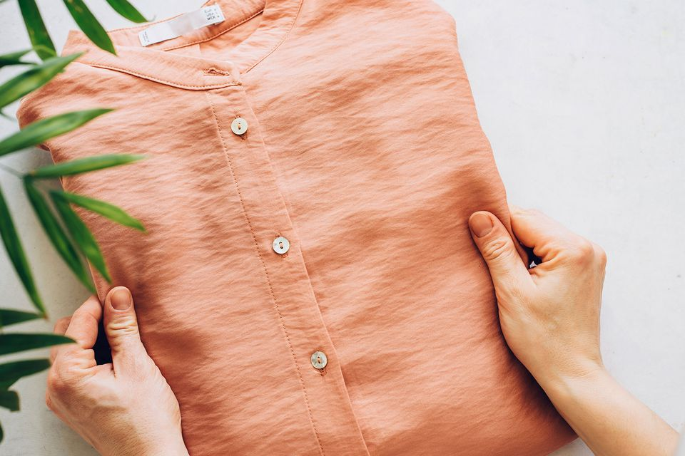 Orange button-downed acetate shirt folded by hand