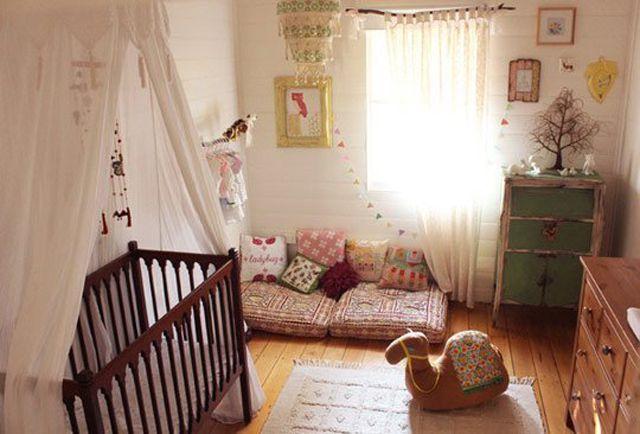 Beautiful bohemian girl nursery with rustic charm