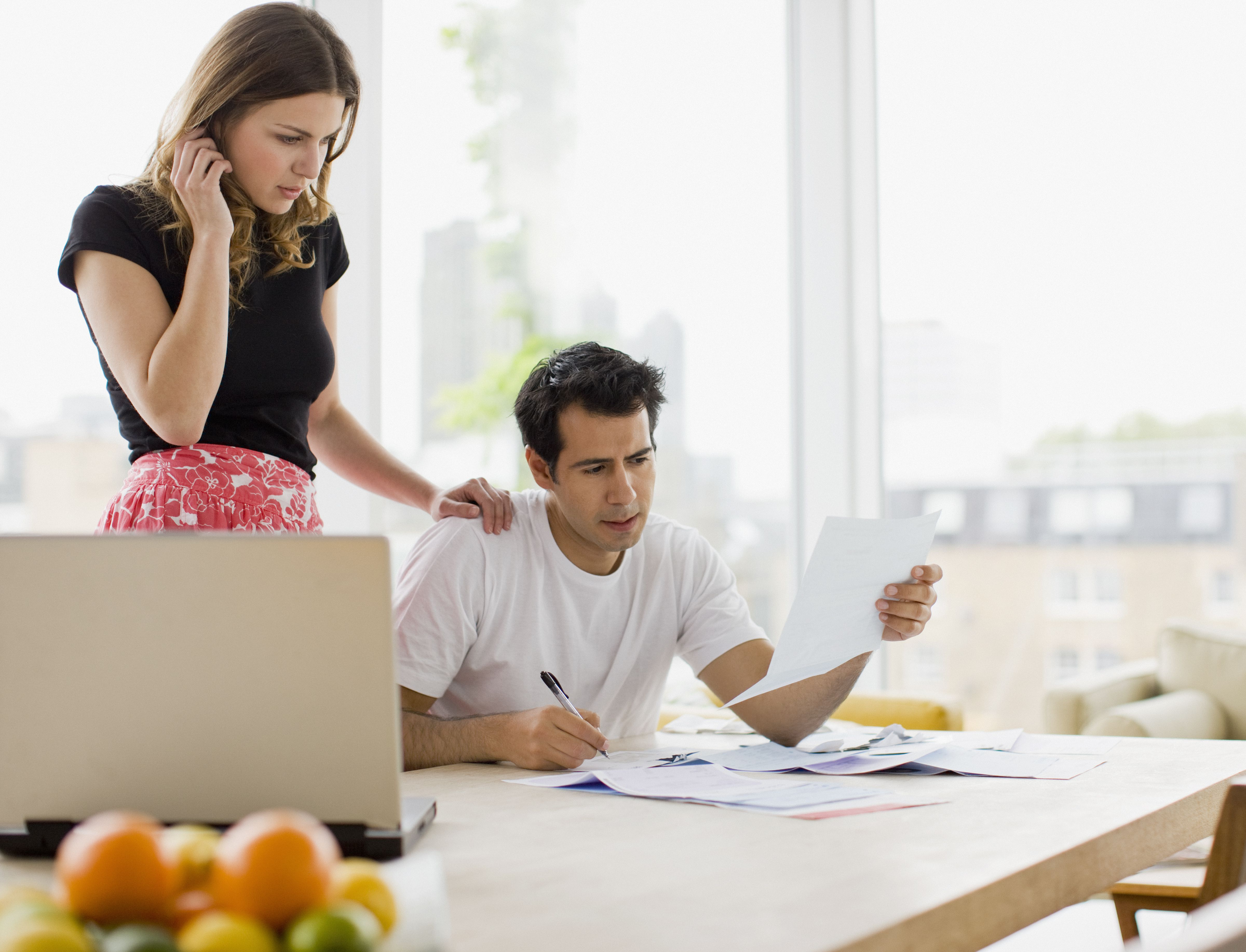 Concerned couple paying bills together