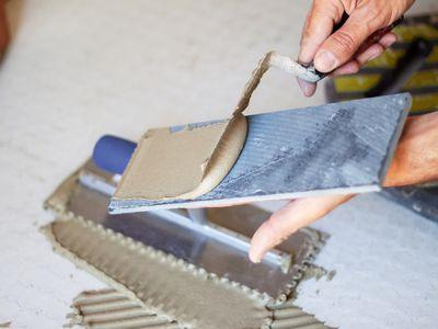 Man applying tile adhesive