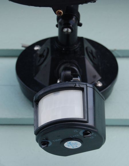 Security lights that detect motion and body heat a motion detector attached to a garage aloadofball Choice Image