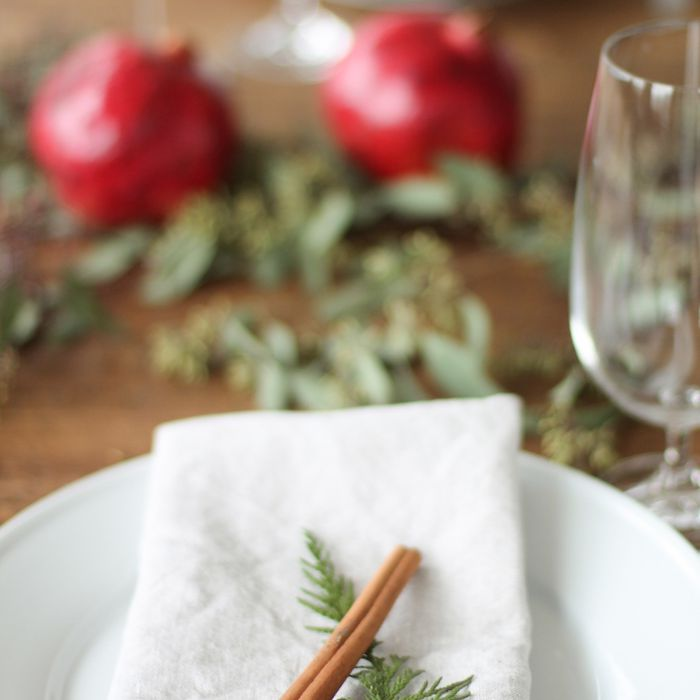 Cinnamon stick resting on a folded napkin for a Christmas table.