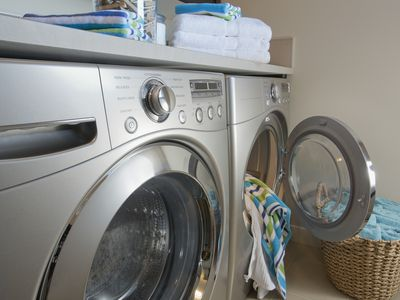 Laundry room with focus on energy efficient washer and dryer.