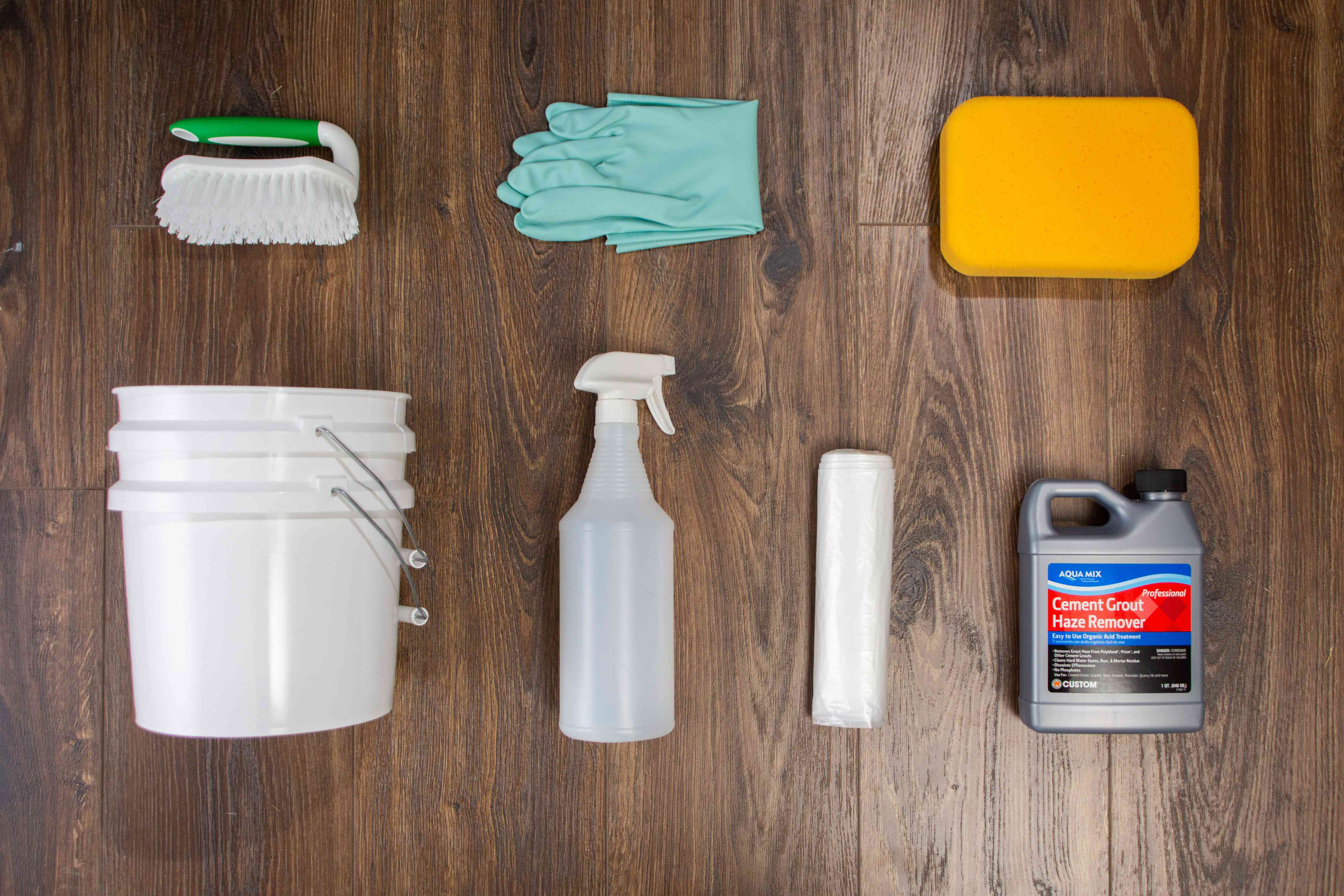 Tools and materials to clean grout haze